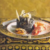 BLACK RISOTTO WITH TRUFFLES AND LEAVES OF GOLD, LOBSTER AND COCKLES