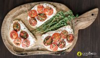 Bruschetta with tomatoes,thyme and xino-myzithra  traditional unpasteurised Greek cheese