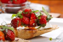 Bruschetta with strawberries, basil and cream cheese.