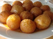 Cheese Puffs with Sesame and Honey