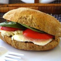 FOOD - ITALY - MOZZARELLA, TOMATO AND BASIL SANDWICH