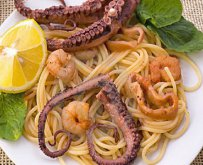 Octopus with pasta in tomato sauce