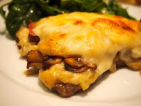Finely Sliced Veal with Mushrooms and Cheese in the Oven