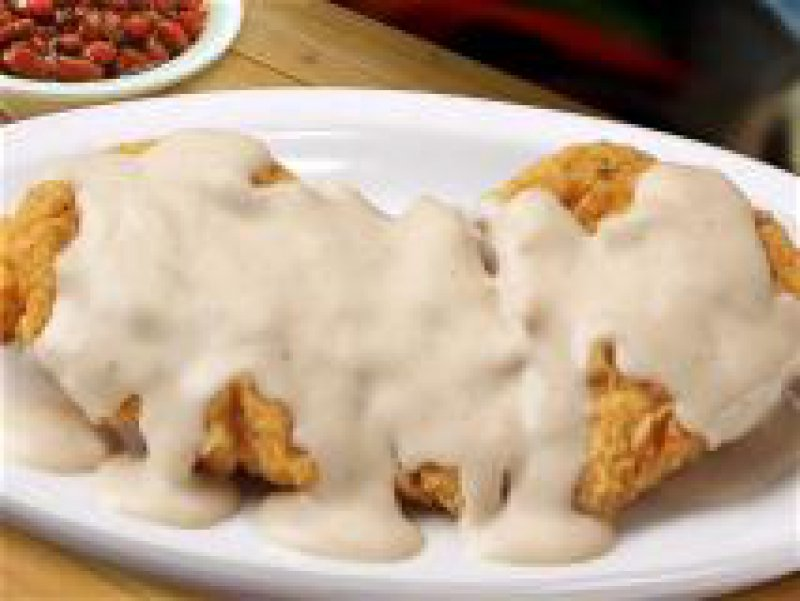 Fried Chicken Fillets with Almonds in a Feta Cheese Sauce