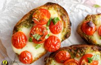 Bruschetta with grilled cherry tomatoes and Greek traditional cheese metsovone