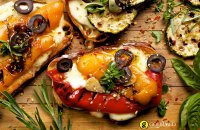 Bruschetta with Greek graviera cheese from Crete and grilled vegetables