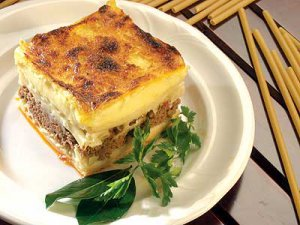 Greek pasta with minced meat and bechamel sauce in the oven